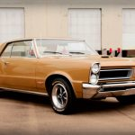 Check this Beautiful Tiger Gold 1965 Pontiac GTO